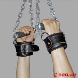 Overhead restraints with chain and hand cuffs