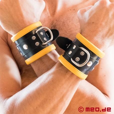 Schwarz / Gelbe Bondage Handfesseln aus Leder