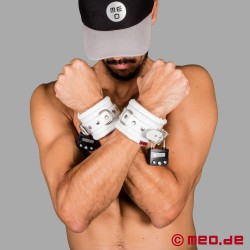 White leather wrist restraints with time lock