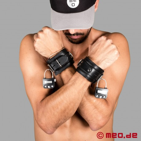 Lockable leather wrist cuffs with time lock