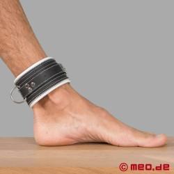 Manette per caviglie in bianco e nero